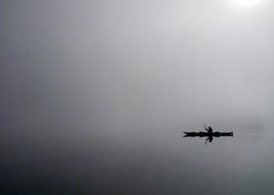 A lone kayaker paddles across Hornet Passage.